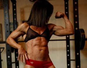 Mature female bodybuilder Tonya is posing in the gym