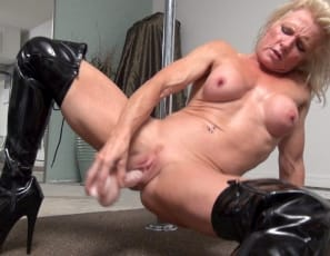 Flexible Mandy Foxx is masturbating in her bedroom in shiny thigh-high boots