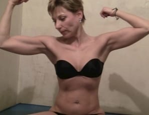 flexing her muscular biceps and showing you just how flexible she is