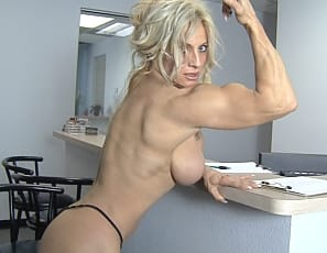 She makes sure this client doesn't mind waiting by showing him her beautiful pecs, powerful biceps and strong, long legs