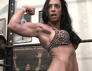 showing off her tattooed. muscular body. Strong biceps, taut abs, and beautiful glutes
