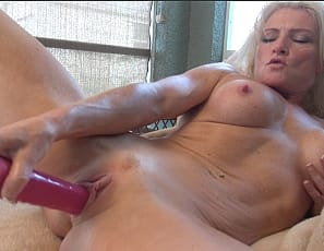 Female muscle porn star Devon Michaels plays with her throbbing pussy and ass
