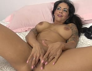 Tattooed, nude female bodybuilder and muscle porn star True Fit poses