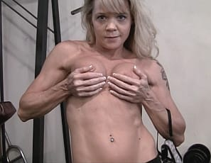 Mandy K in the gym, watching her as she trains the hard, mature muscles