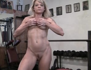 Female bodybuilder Mandy K takes off her panties and poses naked and barefoot in the gym