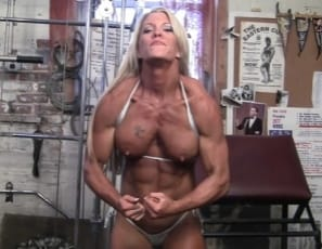 Female bodybuilder Ginger Martin, posing in the gym, shows you the power of her vascular