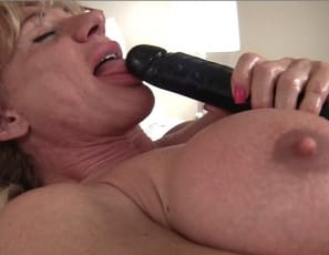 then masturbates her big clit. Enjoy looking at her vascular, muscular legs, biceps and abs