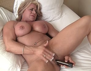 shows you her big clit before pulling out her vibrator and masturbating until her pussy is slimy wet
