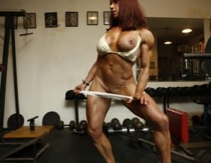Female bodybuilder Oksana poses in the gym, giving you a look from every angle