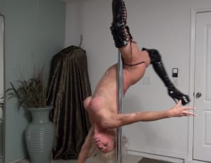 Flexible Mandy Foxx is working her Mature Pecs Biceps, and Abs muscles in thigh-high boots on her gym's stripper pole