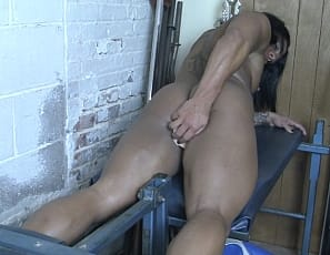 Female muscle porn star and bodybuilder Goddess of Iron is naked on the leg press