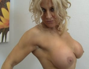 she poses to show off her powerful pecs, strong biceps, tight abs, muscular legs and calves