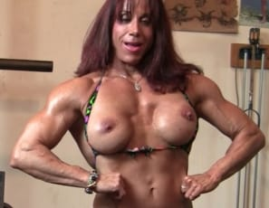 female bodybuilder Oksana as she poses for you in the gym, flexing the mature muscles