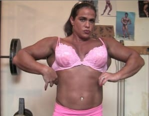 female bodybuilder Dana works the mature muscles of her big biceps and powerful pecs