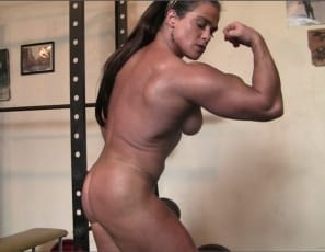 Female bodybuilder Dana works out and poses nude in the gym, showing off her muscle control