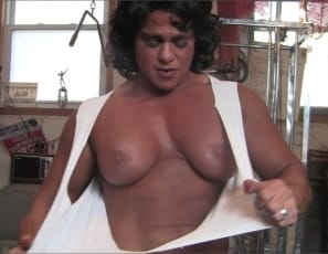 ripped female bodybuilder Dana, as she does bench presses, pushdowns and flys in the gym