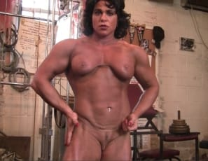 Mature female bodybuilder Dana's working out naked in the gym, training her legs