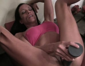 as she penetrates herself with a gigantic toy and masturbates