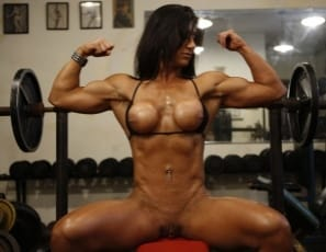 a super-hot female bodybuilder. She shows off her ripped, vascular muscles