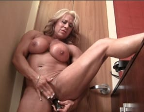 Female bodybuilder Li'l Doll is naked, masturbating her big 2-inch clit
