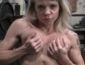 Female bodybuilder Mandy K works her muscles in the gym and poses, showing off her big biceps