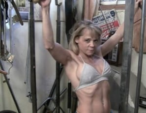 her big biceps and her tight abs as she does dips, then look at her pose