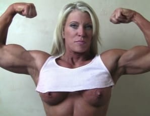 female bodybuilder Ginger Martin, posing and showing off her massive muscles