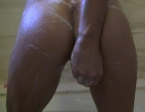 You get to watch in close-up as she shaves her pussy clean